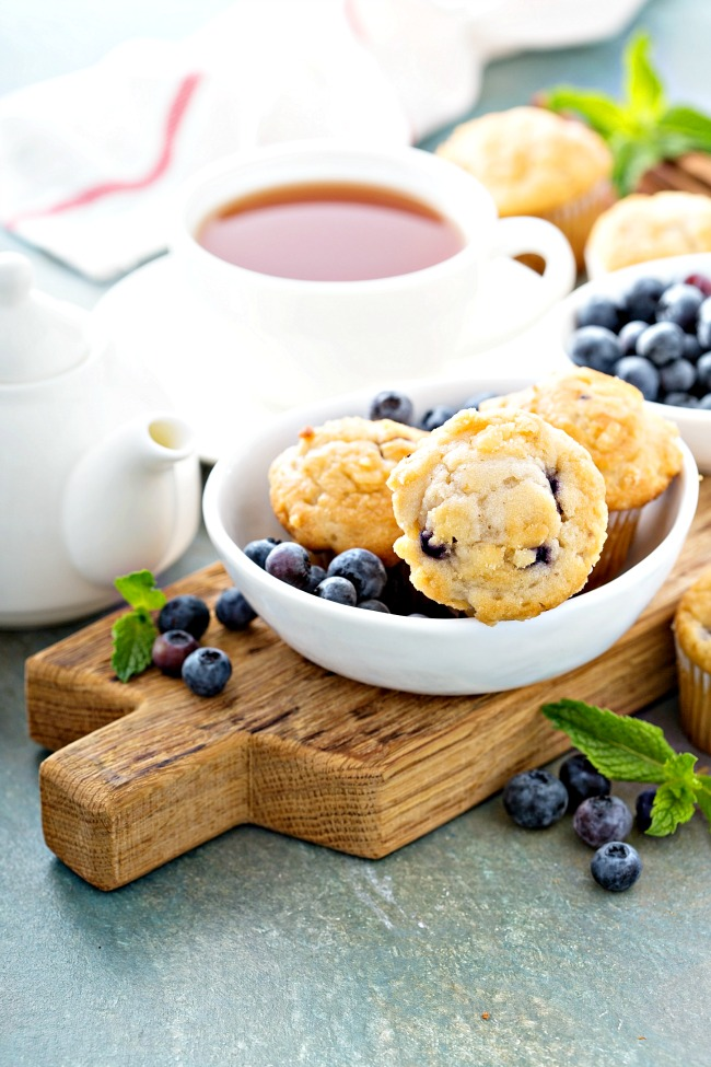 tender blueberry muffins in a bowl.