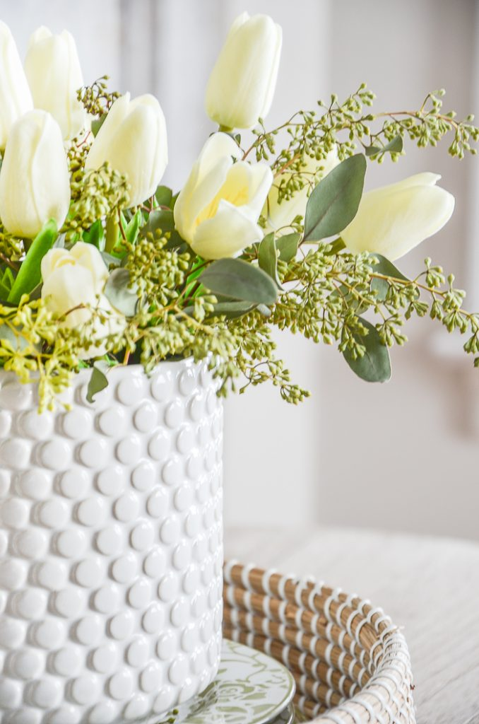 spring inspired vignette with white tulips