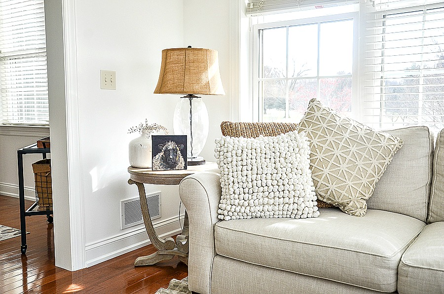 white sofa with table and lamp