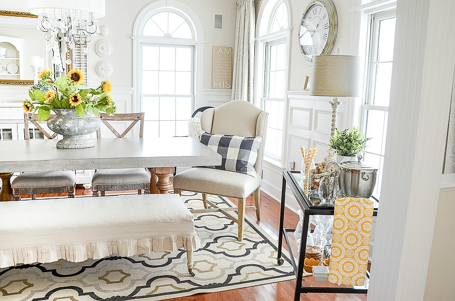dining room with neutral colored head chairs