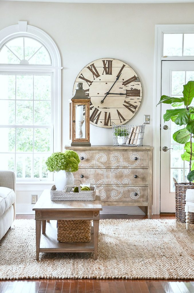 beautiful large clock above an embellished chest