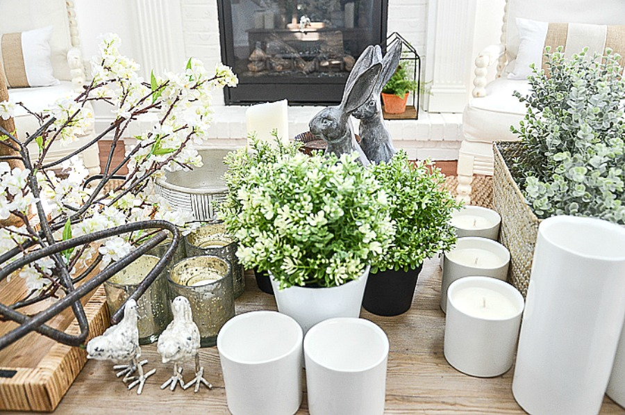 table filled with spring decor for a mantel