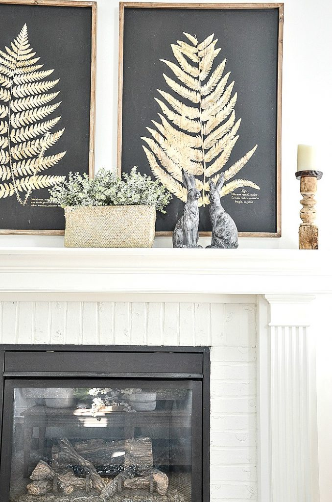 basket of faux greens on a spring mantel