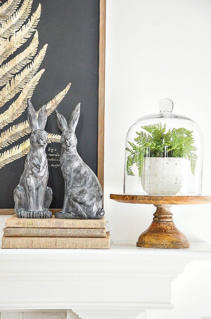 fern under a cloche on a pedestal cake plate