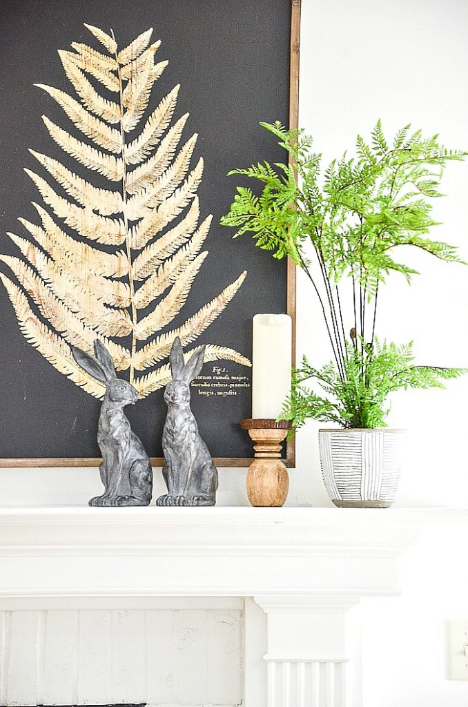 REABBITS AND FERNS ON A MANTEL
