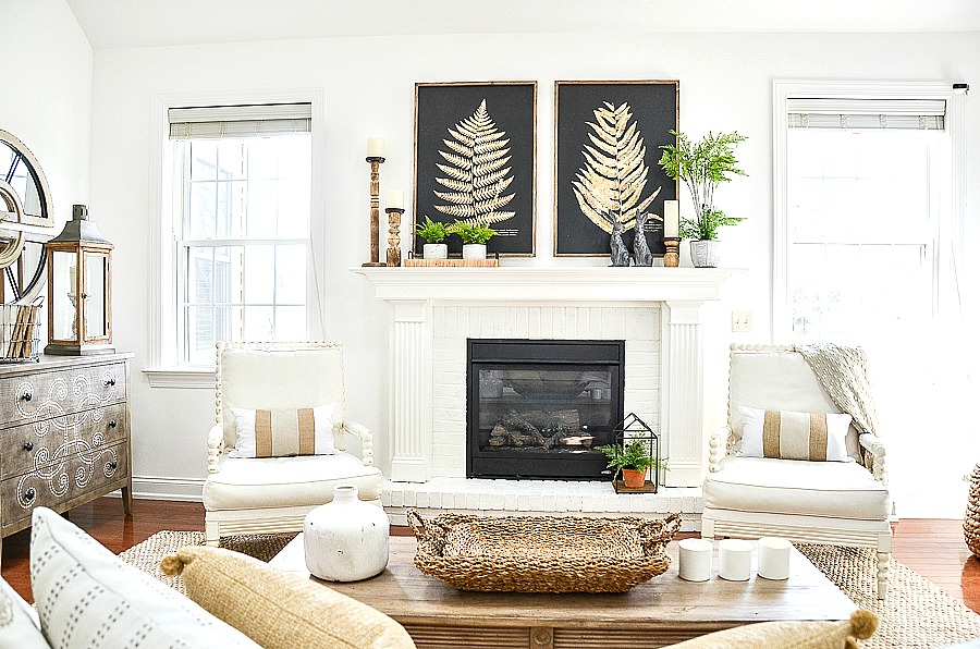 neutral colored room with ferns and handsome soapstone rabbits on the spring inspired mantel