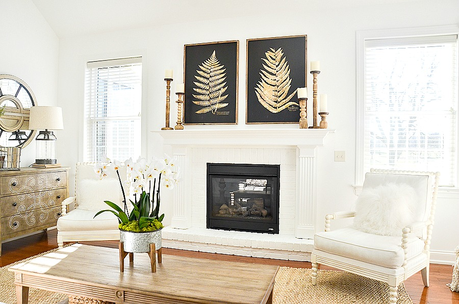 living room with large white fireplace
