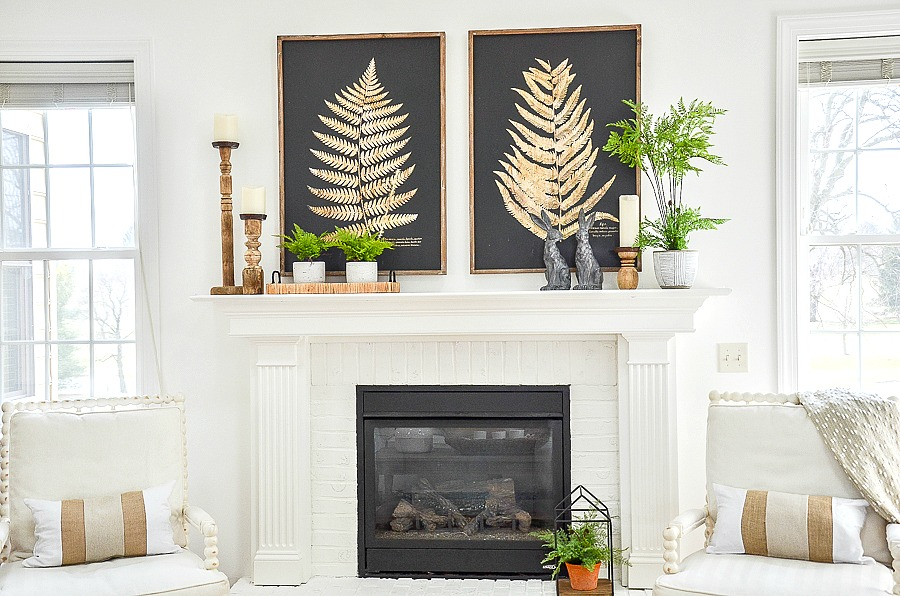 neutral colors and green ferns on a spring mantel