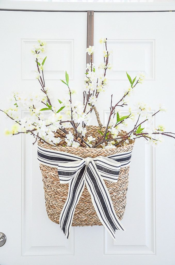 spring basket filled with white flowering branches