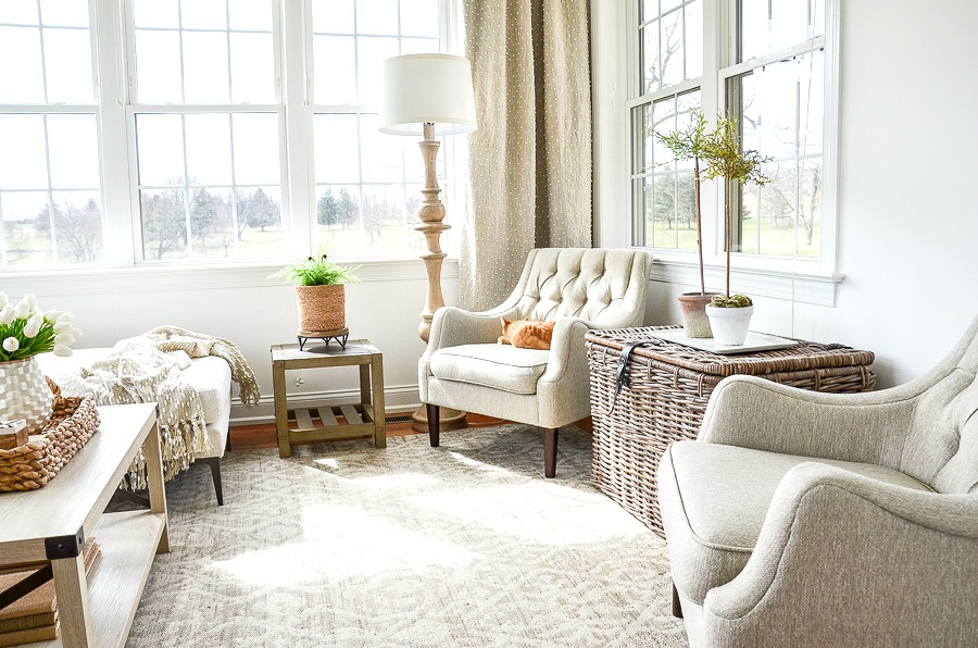 a neat and organized sunroom
