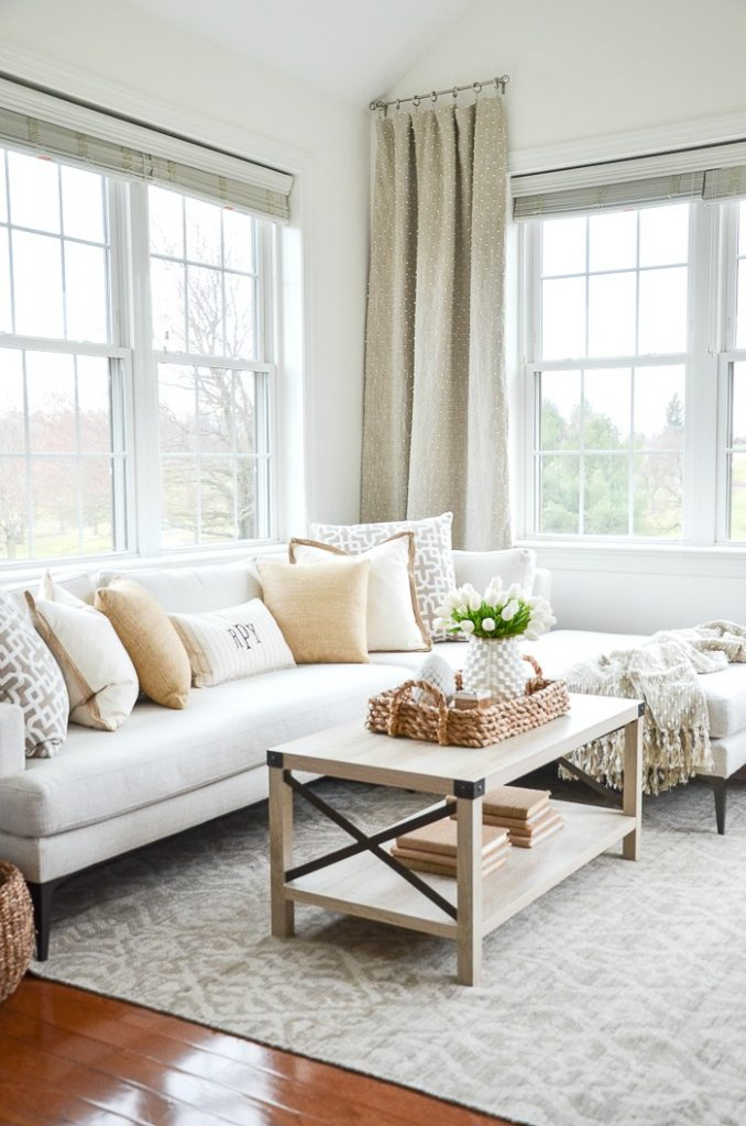 white chaise in a small room