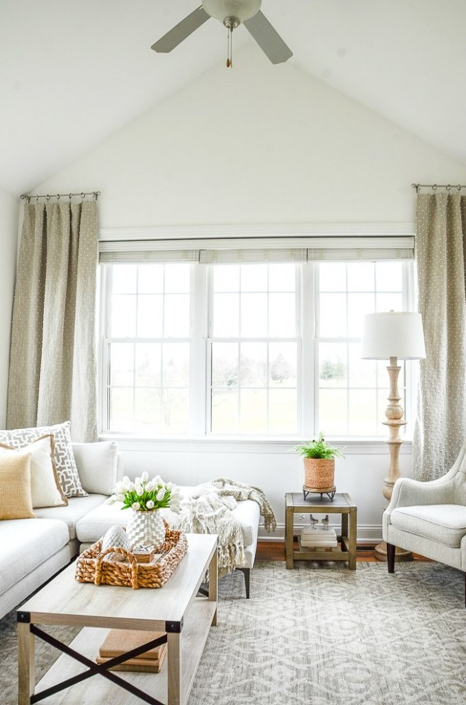 white sectional with chaise in the sunroom