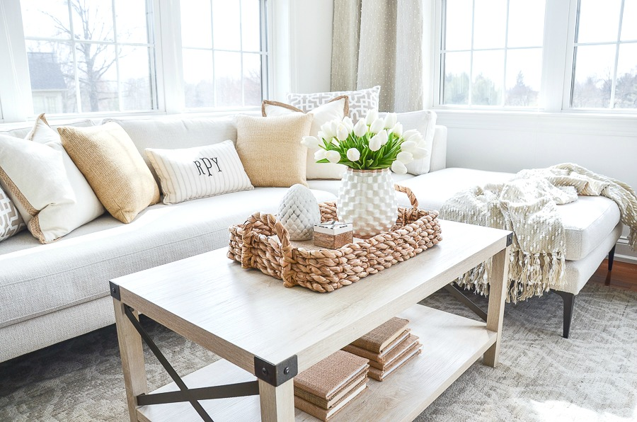 coffee table and sectional in a small room