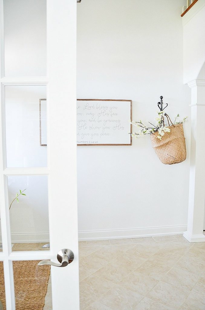 WHITE ENTRYWAY WITH BASKET OF APPLE BLOSSOM BRANCHES