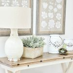 TABLE WITH WHITE URN LANTERS