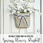 PRETTY SPRING BASKET OF FLOWERS HANGING ON A FRONT DOOR