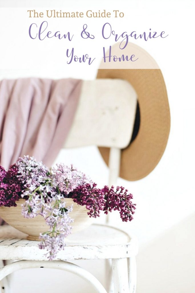 a container of lilacs on a white chair