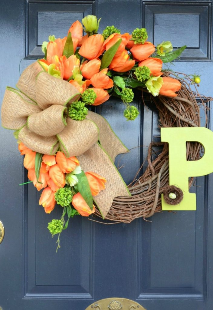orange tulip wreath on a blue door