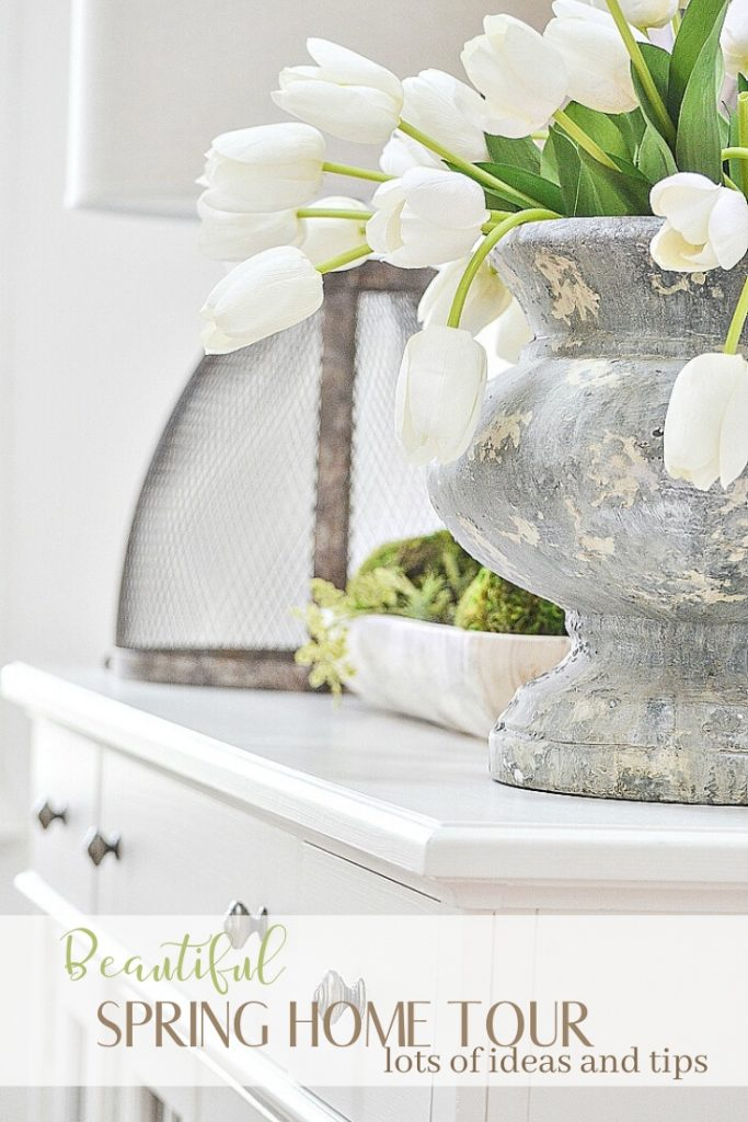 gray urn with white tulips