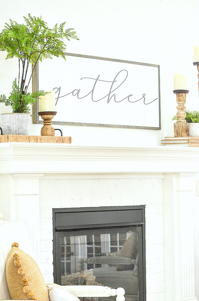WHITE FIREPLACE WITH SPRING DECOR