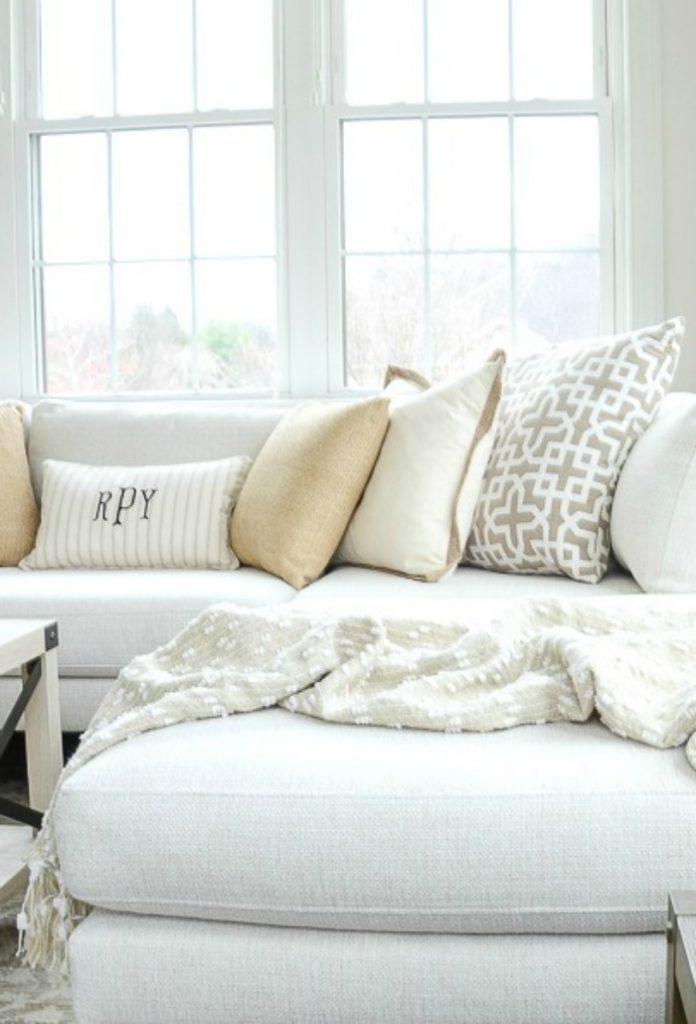 white sofa with pretty neutral pillows