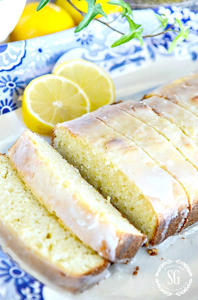 BEAUTIFUL LEMON LOAF CAKEON A BLUE AND WHITE DISH