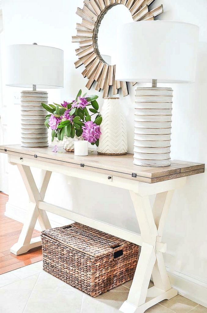 foyer table decorated beautifully. A foyer table make a first impression in our homes
