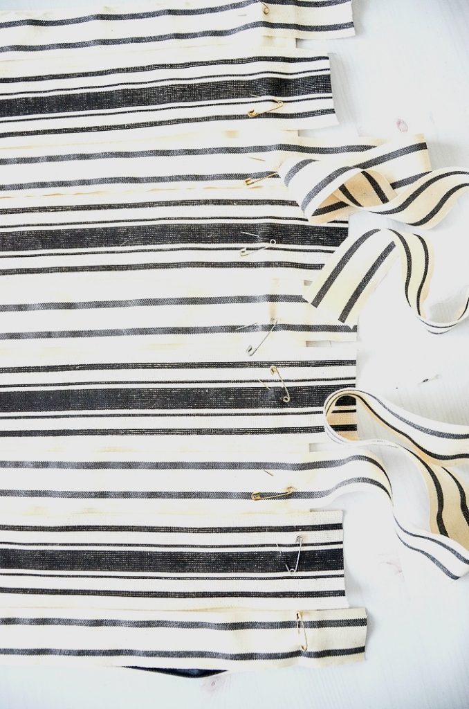 black and white ribbons pinned to a pillow cover