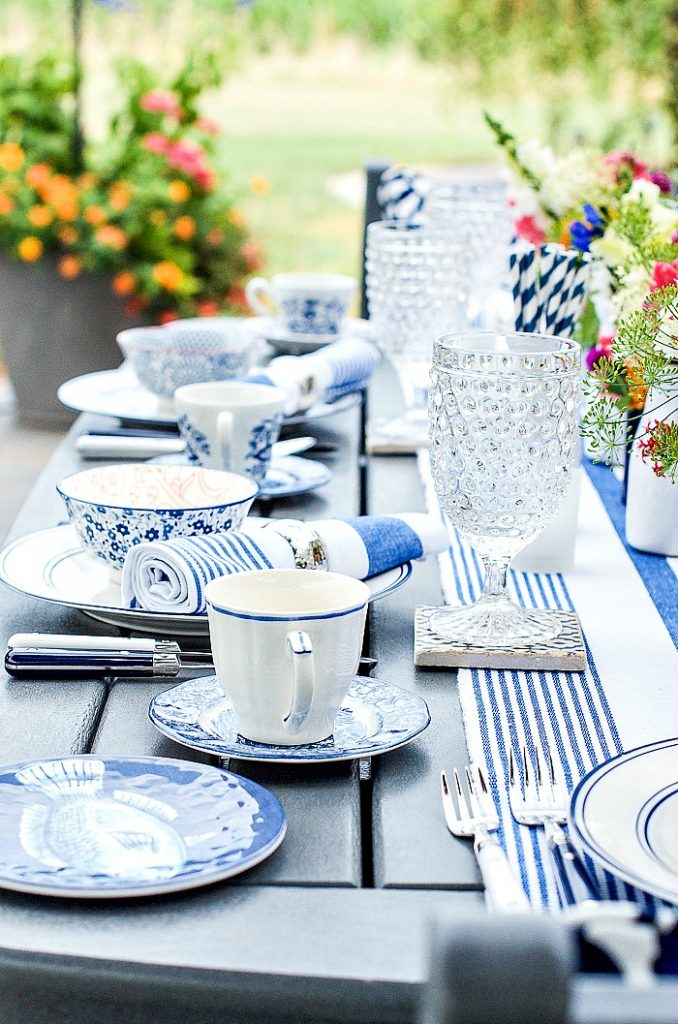 blue and white table outside on patio