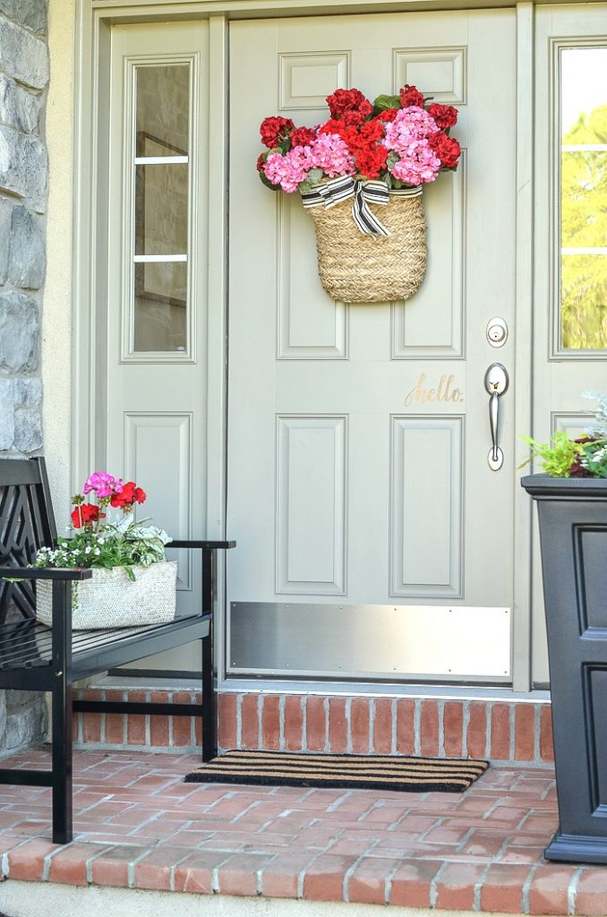 PRETTY AND COLORFUL FLOWERS ON A SMALL FRONT PORCH
