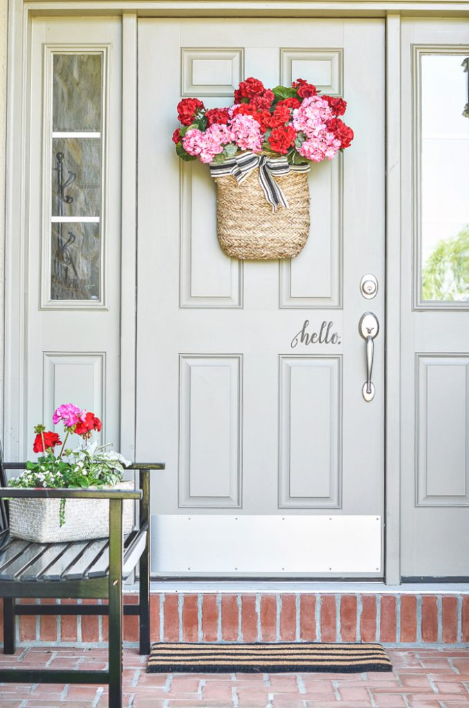DOOR WITH BASKET OF SUMMER FLOWERS HUNG ON IT