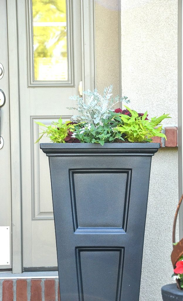 TALL BLACK PLANTER WITH ANNUALS