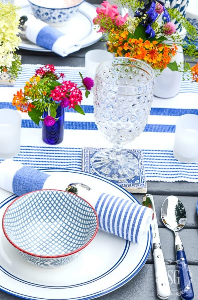 BLUE AND WHITE OUTDOOR TABLE WITH GARDEN FLOWERS