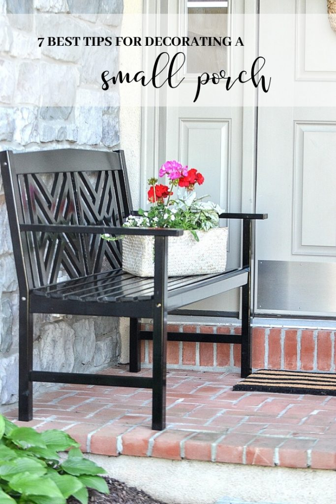 front porch with black bench
