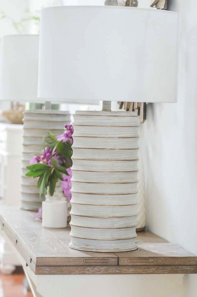 close up of a lamp on a foyer table. a lamp is an essential part of a foyer table