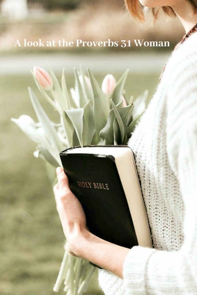 a woman holding tulips and a Bible
