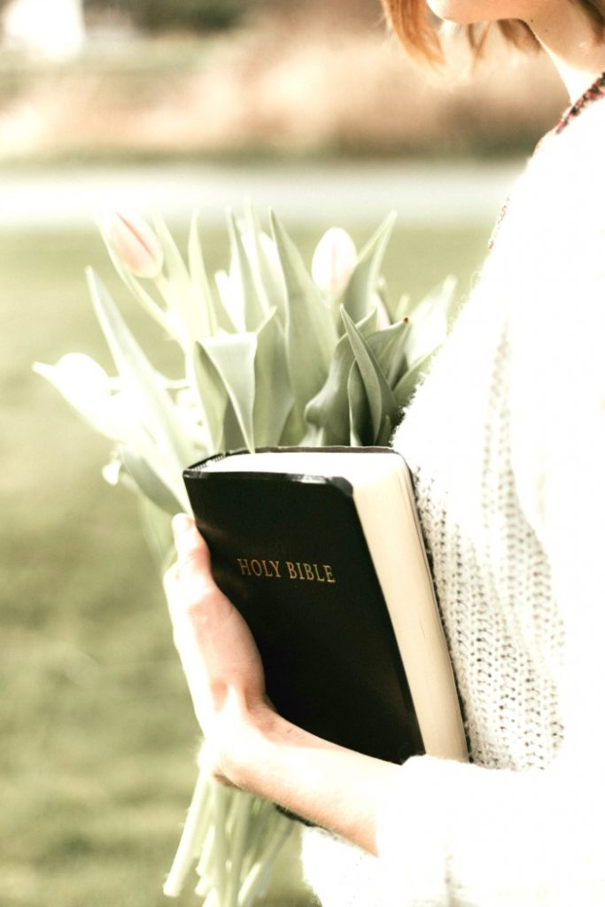 GIRL HOLDING TULIPS AND A BIBLE