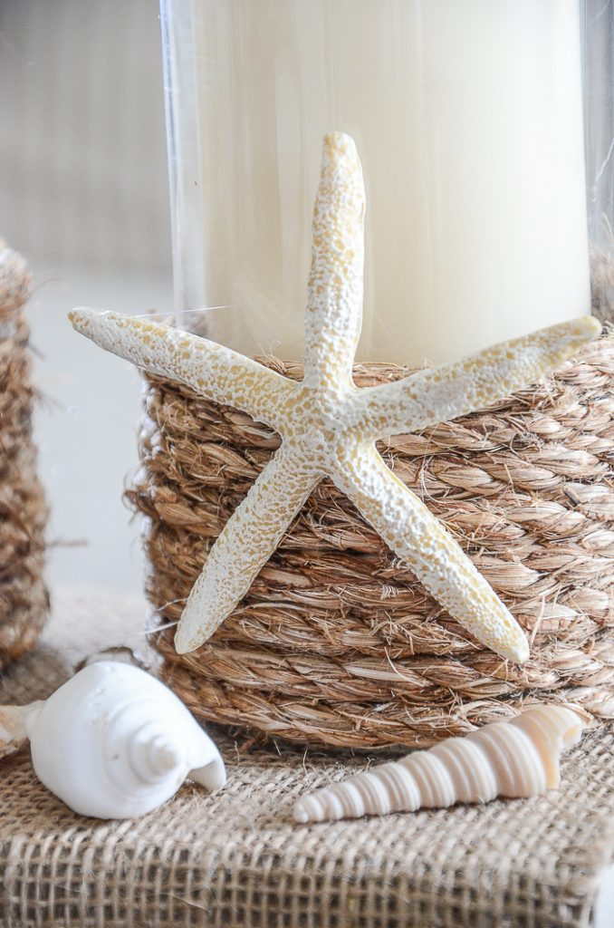 candleholders with rope and a starfish
