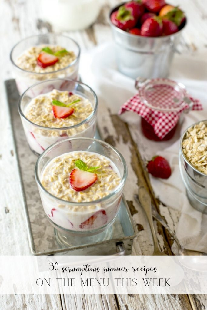 Three bowls of oatmeal with strawberries