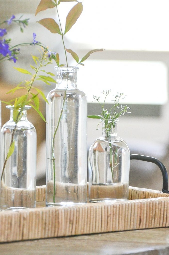 PRETTY GLASS BOTTLES FILLED WITH FORAGED GREENS