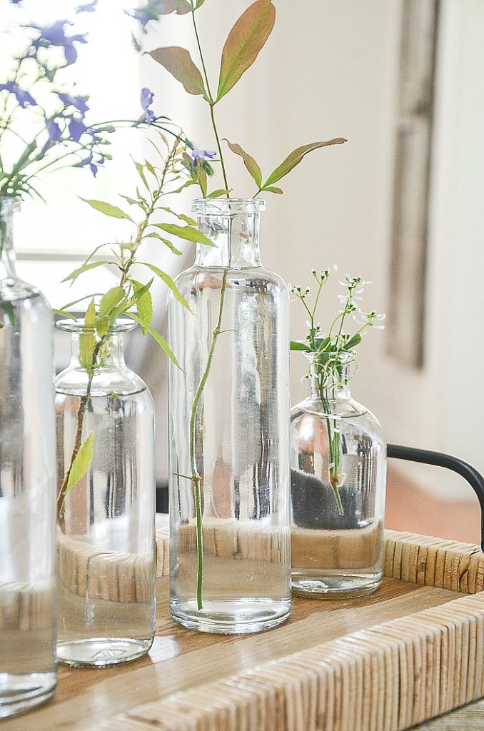 TWIGS IN BOTTLES FOR AN EASY SUMMER CENTERPIECE