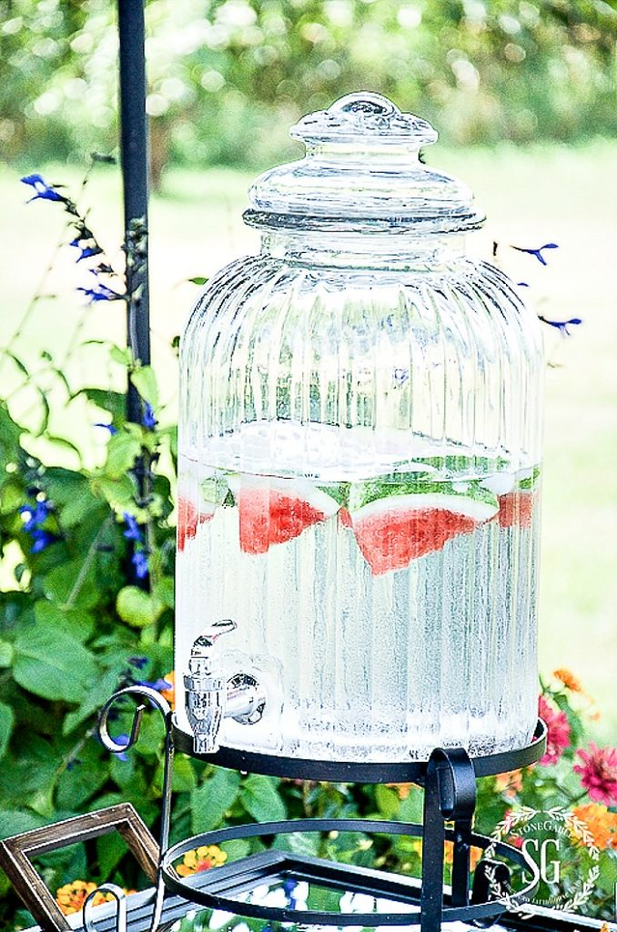 WATER JAR outside on a bar cart
