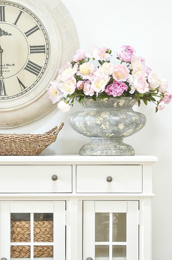 LARGE GRAY URN FILLED WITH PINK PEONIES FOR A SUMMER HOME TOUR