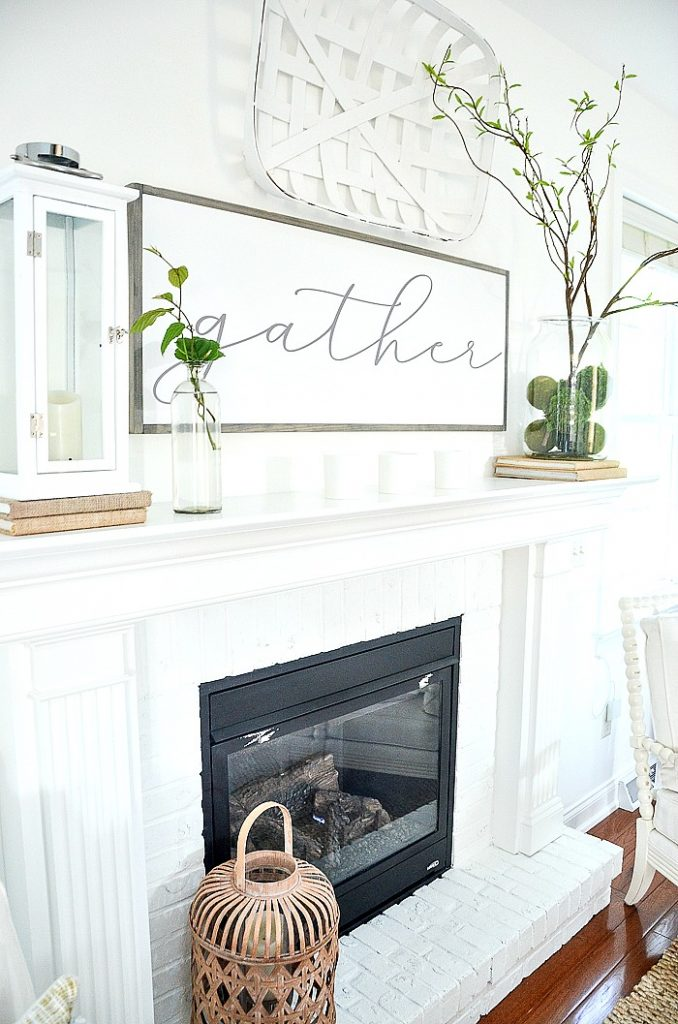 WHITE FIREPLACE THAT IS A FOCAL POINT OF A ROOM