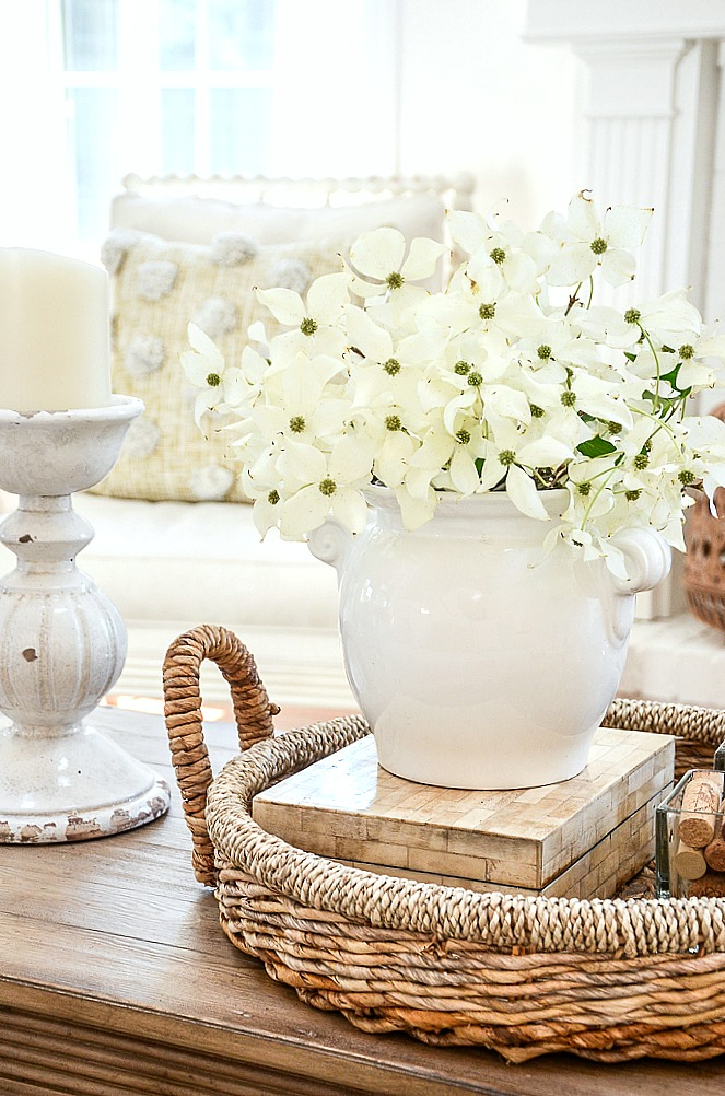 DOGWOOD FLOWER ARRANGEMENT ON A COFFEE TABLE