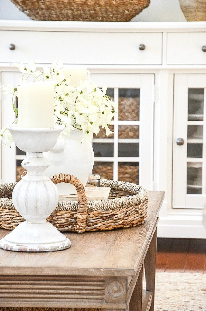 BIG ROUND BASKET ON A COFFEE TABLE FILLED WITH SUMMER DECOR
