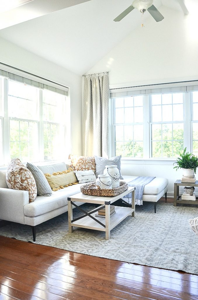 SUNROOM SECTIONAL DECORATED WITH SUMMERY PILLOWS