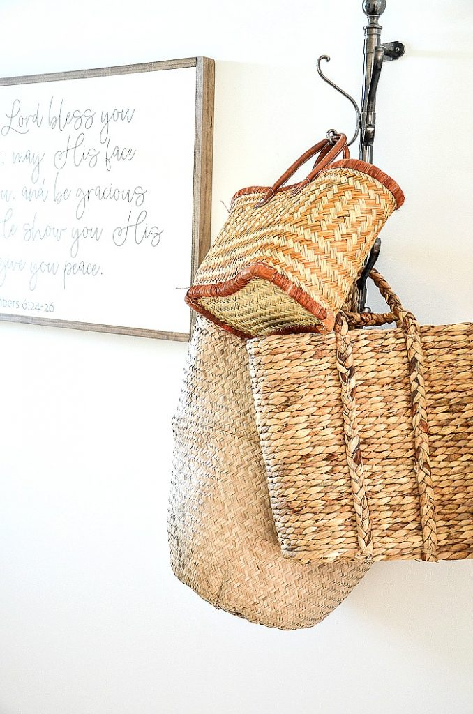 BASKETS IN A FOYER ON A VERTICAL COAT HOOK