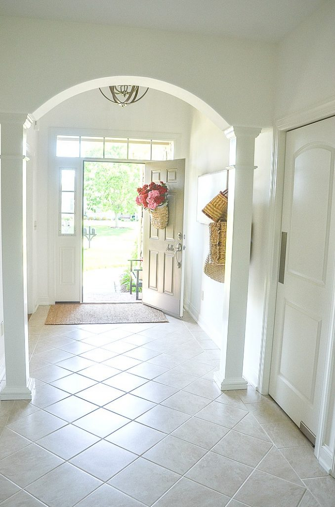 WHITE FOYER WITH OPEN DOOR FOR A SUMMER HOME TOUR