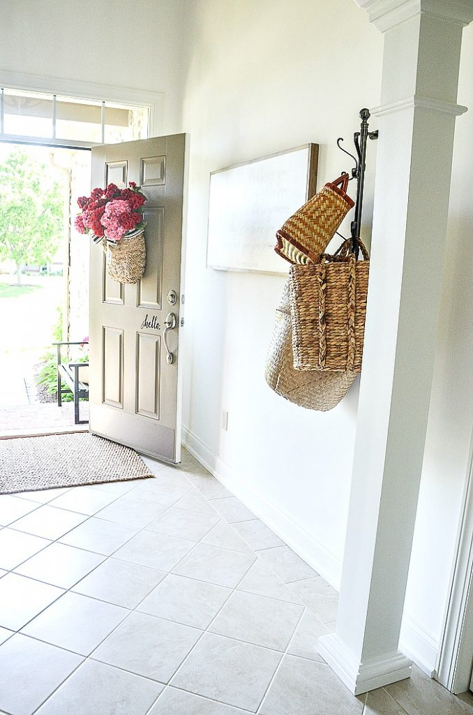 white foyer in a summer home tour